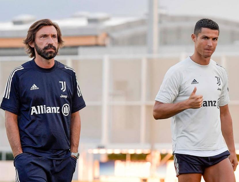 Andrea Pirlo bersama Cristiano Ronaldo di latihan Juventus.