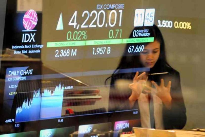 Angka pergerakan indeks harga saham gabungan (IHSG) pada layar di Bursa Efek Indonesia (BEI), Jakarta