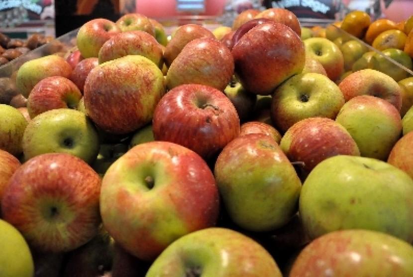 Apel malang kalah bersaing dengan apel impor.