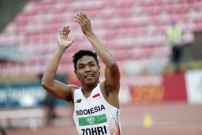 Pelari Indonesia Lalu Muhammad Zohri melakukan selebrasi seusai menang dalam perlombaan Atletik IAAF World U20 Championships cabang lari 100 meter di Tampere, Finlandia, Kamis (11/7). Lehtikuva/Kalle Parkkinen via REUTERS