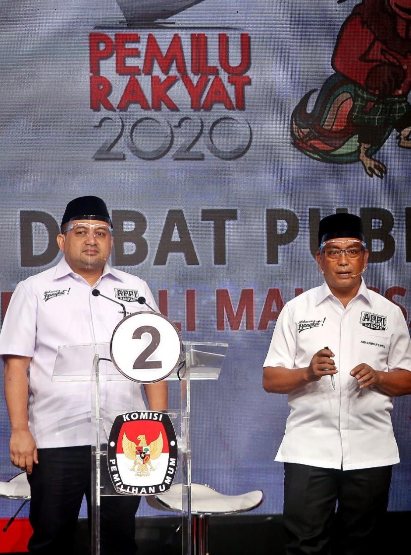 Calon Wali Kota Makassar Munafri Arifuddin dan calon Wakil Wali Kota Makassar Rahman Bando saat debat pilkada, Selasa (24/11)