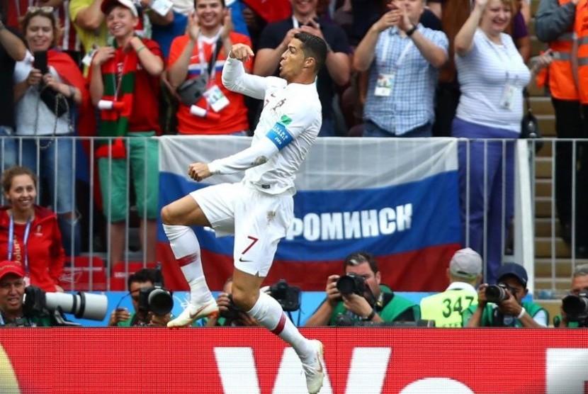 Cristiano Ronaldo merayakan gol ke gawang Maroko, Rabu (20/6).