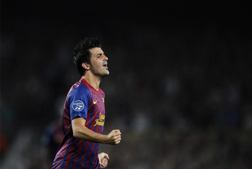 David Villa melakukan selebrasi usai menciptakan gol ke gawang AC Milan dalam pertandingan Liga Champions Grup H di Nou Camp, Barcelona, Spanyol, 13 September 2011.