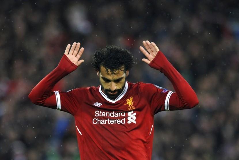 Ekspresi Mohamed Salah seusai menjebol gawang AS Roma.