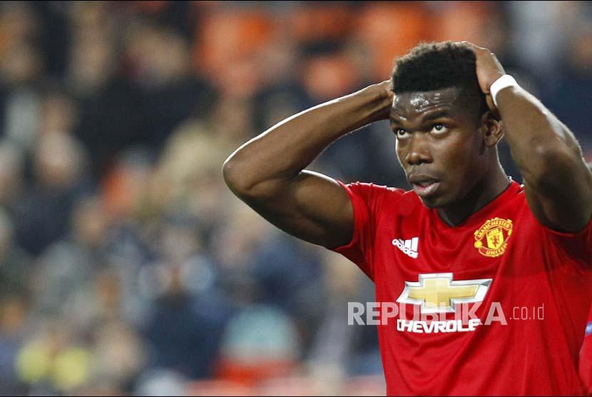 Ekspresi Paul Pogba saat gagal mencetak gol pada laga Grup H Liga Champions Eropa antara Valencia melawan Manchester United di Valencia Stadium, Valencia, Spanyol, Rabu (13/12) dini hari.