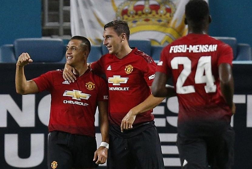 Ekspresi penyerang Manchester United Alexis Sanchez (kiri) seusai menjebol gawang Real Madrid, Rabu (1/8).