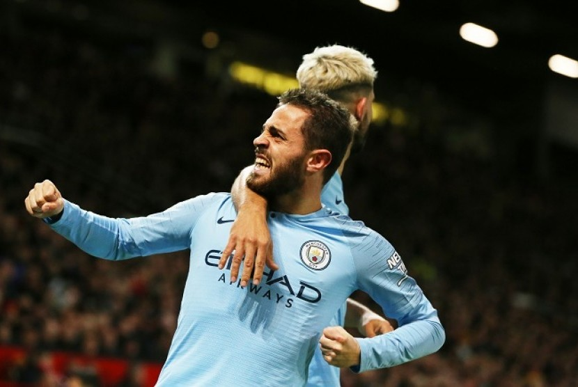 Gelandang Manchester City Bernardo Silva merayakan golnya ke gawang Manchester United.