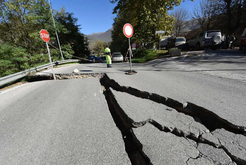 Street cracks following an earthquake. (Illustration)
