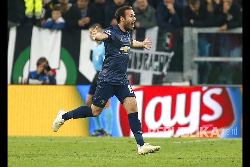 Juan Mata merayakan gol balasan Setan Merah pada laga Juventus vs Manchester United di Allianz Stadium, Turin, Itali, Kamis (8/11) dini hari.