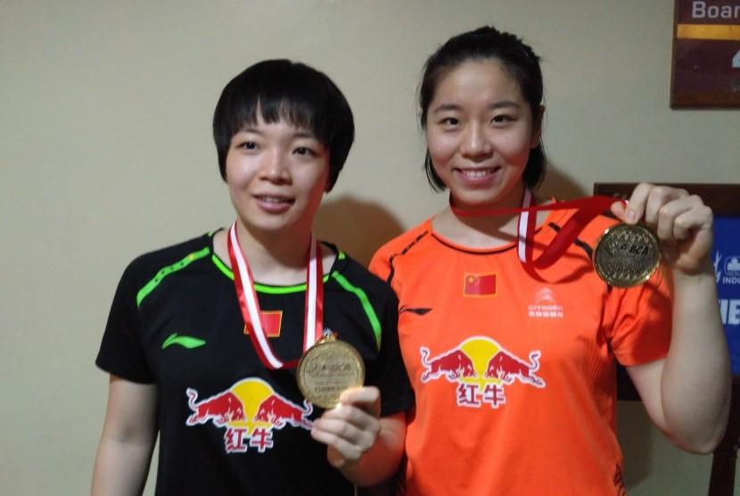 Juara ganda putri asal Cina, Chen Qingchen/Jia Yifan menjadi juara di turnamen BCA Indonesia Open Super Series Premier 2017, Ahad (18/6).