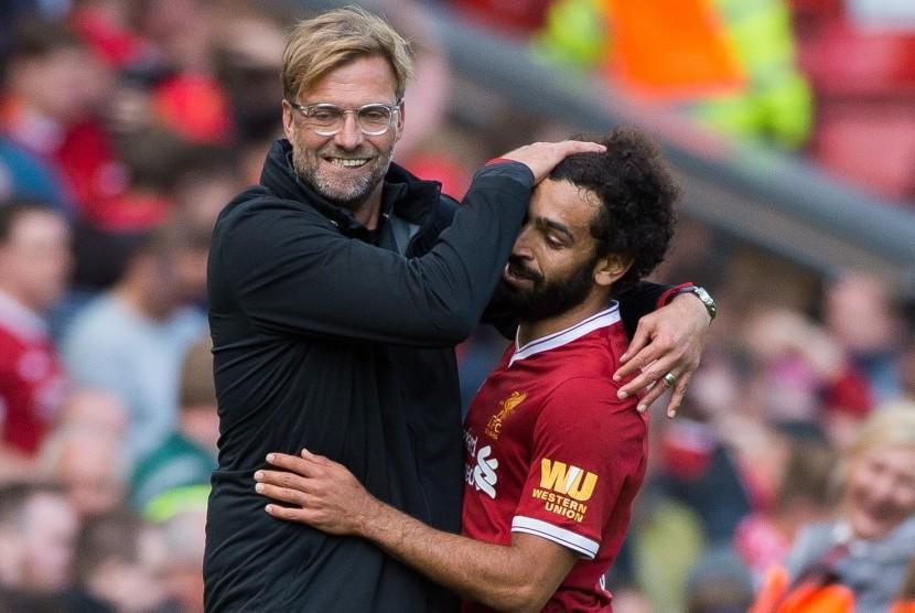 Juergen Klopp (kiri) dan Mohamed Salah (kanan)