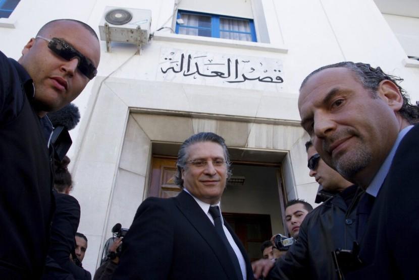 Kandidat presiden Tunisia 2019 Nabil Karoui (tengah). Foto diambil pada 2012.