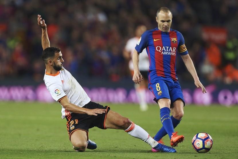 Kapten Barcelona pada laga La Liga lawan Valencia di Camp Nou, Senin (20/3) dini hari WIB. Barca menang 4-2.