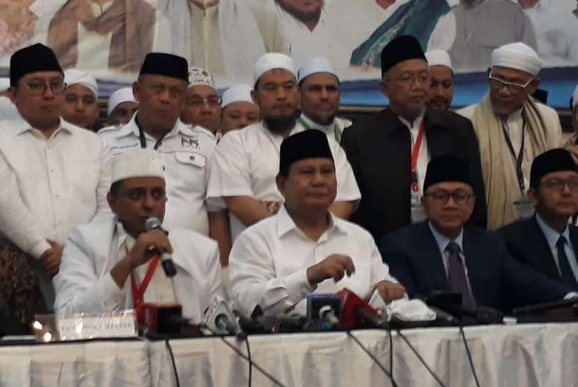 GNPF Ulama chairman ustaz Yusuf Muhammad Martak, Prabowo Subianto and Zulkifli Hasan attends Ijtima' Ulama II at Grand Cempaka hotel, Jakarta, Sunday (Sept 16)