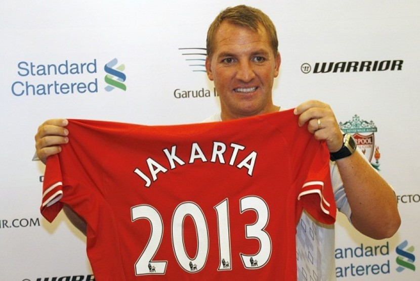 Liverpool's manager Brendan Rodgers holds a jersey during a press conference in Jakarta, Indonesia, Thursday, July 18, 2013. Liverpool is on the 2013 summer tour to Indonesia, Australia and Thailand.