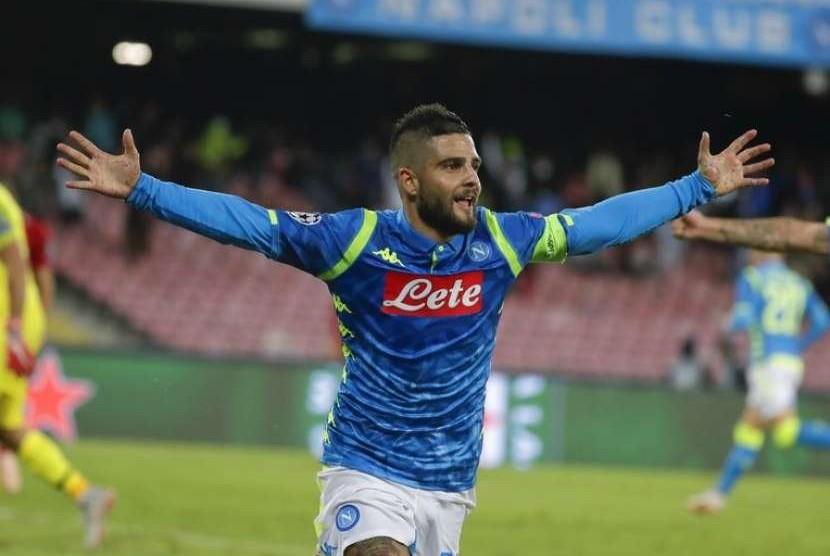 Lorenzo Insigne merayakan gol kemenangan Napoli yang dicetaknya ke gawang Liverpool.