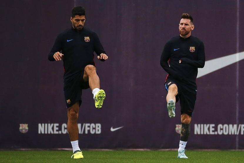 Luis Suarez dan Lionel Messi.