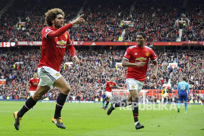Manchester United meraih kemenangan 2-1 atas Arsenal pada laga pekan ke-35 Liga Primer Inggris di Old Trafford, Ahad (29/4) malam WIB.