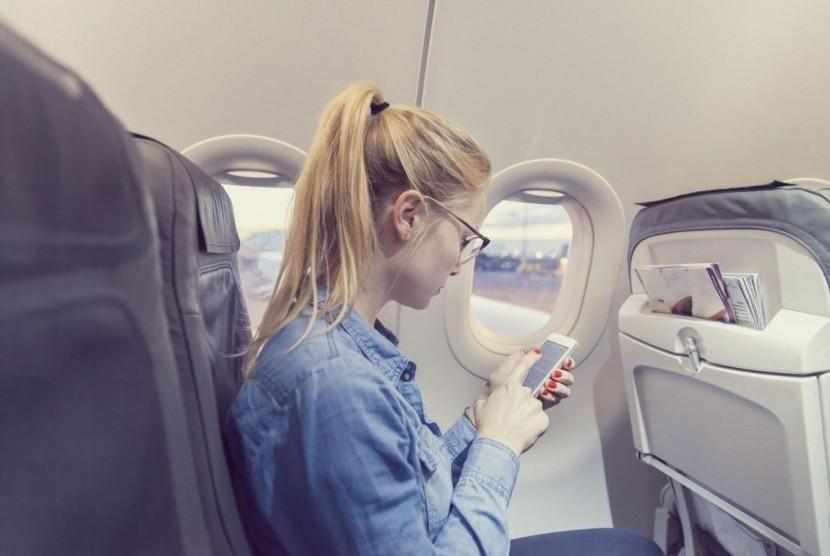 Memilih kursi di dalam pesawat