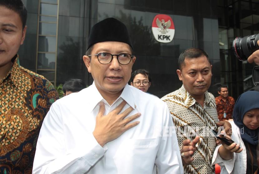 Menteri Agama Lukman Hakim Saifuddin berjalan meninggalkan gedung KPK seusai memenuhi panggilan pemeriksaan penyidik Komisi Pemberantasan Korupsi (KPK) di Jakarta, Rabu (22/5/2019).
