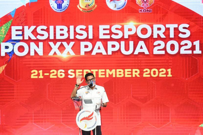 Menteri Pariwisata dan Ekonomi Kreatif (Menparekraf) Sandiaga Uno membuka pertandingan ekshibisi EsportsPekan Olahraga Nasional (PON)XX Papua, Selasa (21/9).