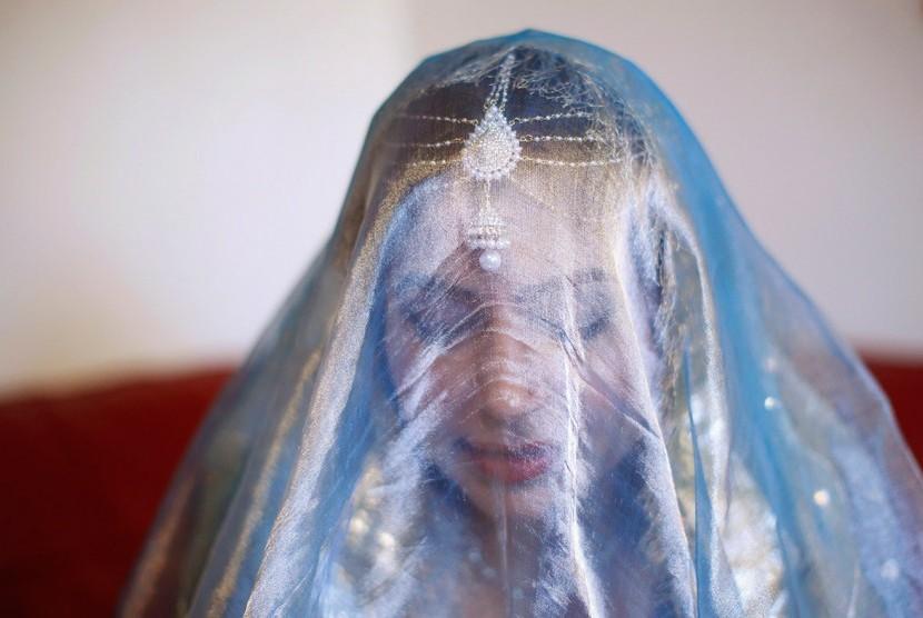 Suara Saat Tidur Berkata tentang Islam, Natalia Jadi Mualaf. Foto:  Muslimah mualaf (ilustrasi).