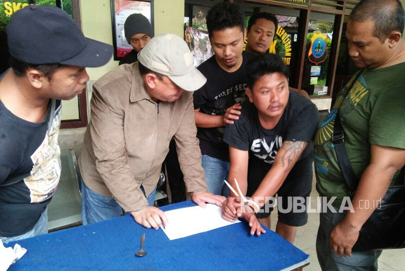 Oknum Polisi Brigadir Polisi Jumadi yang melakukan perampokan Rp 10 Miliar pada Bank Mandiri Kalimantan Selatan.