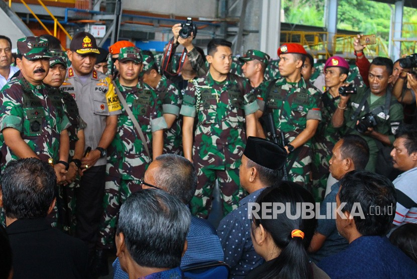 Indonesian Defense Forces (TNI) Commander Marshal Hadi Tjahjanto (left) talks to the families of workers killed by armed criminal group (KKB) at Avco hangar, Moses Kilangin Timika airport, Mimika, Papua, Friday (Dec 7).