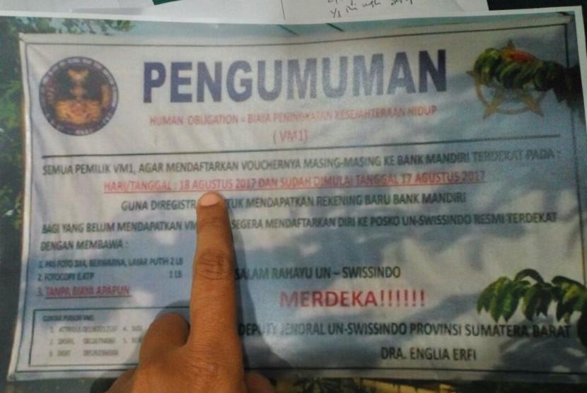 Papan pengumuman penawaran investasi UN Swissindo yang ditemukan di Payakumbuh, Sumatra Barat. Masyarakat diminta lebih hati-hati dalam mendapati tawaran investasi.