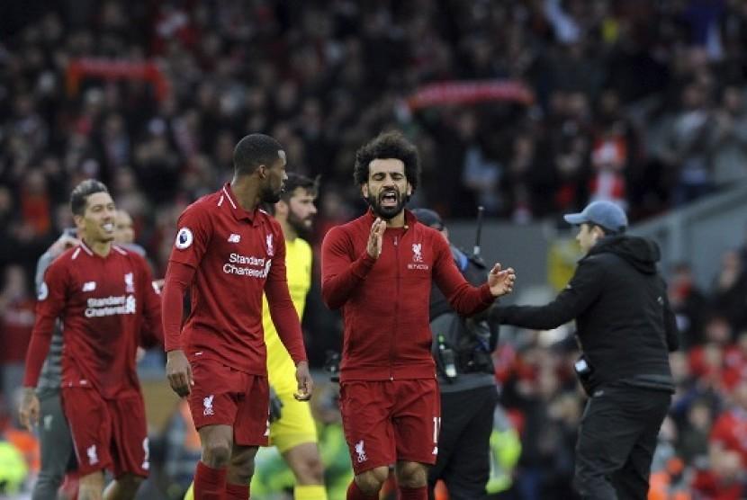 Para pemain Liverpool merayakan kemenangan atas Tottenham Hotspur.
