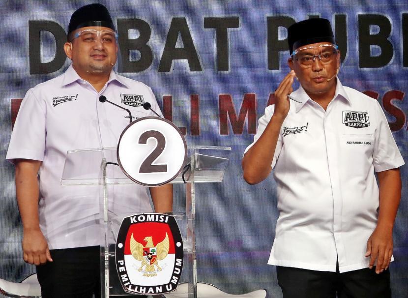 Pasangan calin Wali Kota dan Wakil  Wali kota Makassar Munafri Arifuddin-Abdul Rahman Bando saat debat pilkada debat putaran kedua, Selasa (24/11).