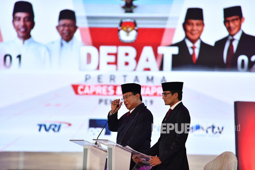 Presidential candidate number 02 Prabowo Subianto (left) accompanied by his running mate Sandiaga Uno answers question of the incumbent President Joko Widodo during the first round of presidential debate at Bidakara Hotel, Jakarta, Thursday (Jan 17).