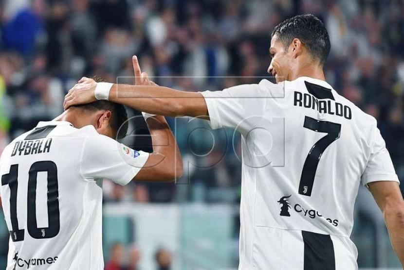 Paulo Dybala (kiri) dan Cristiano Ronaldo.