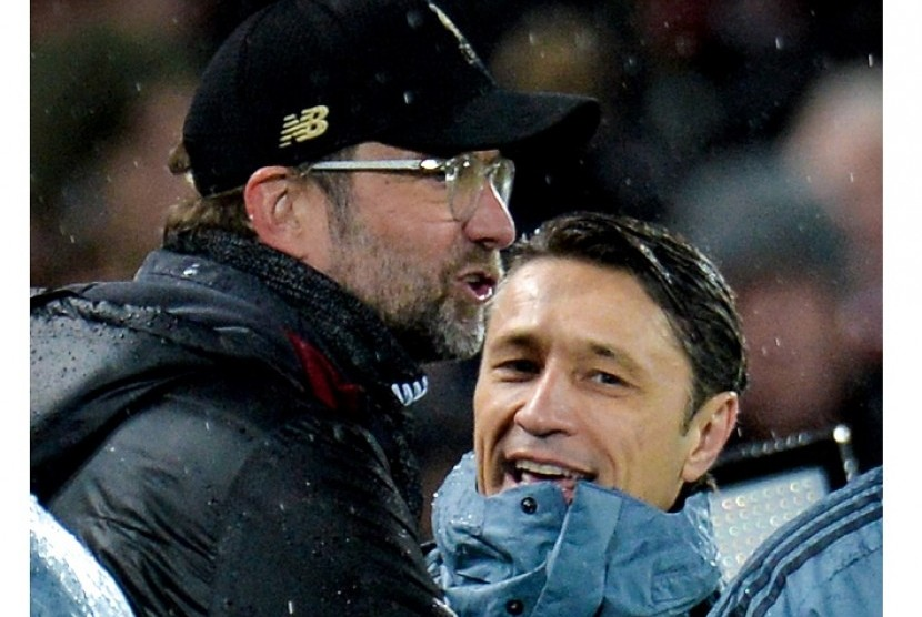 Pelatih Liverpool Juergen Klopp (kiri) dan pelatih Bayern Muenchen Niko Kovac.