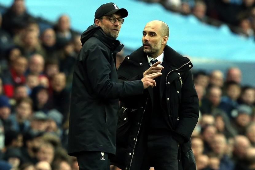 Pelatih Liverpool, Juergen Klopp (kiri) dan pelatih Manchester City, Pep Guardiola.