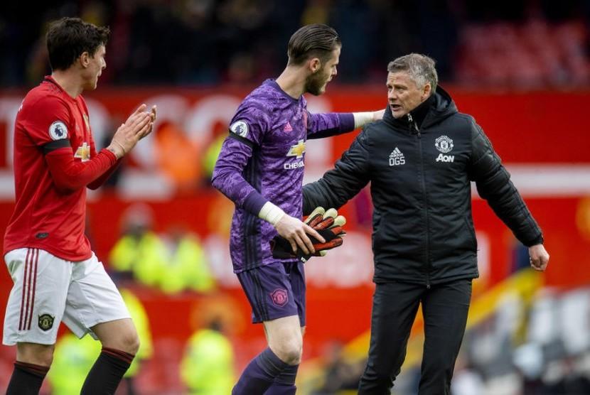 Pelatih Manchester United, Ole Gunnar Solskjaer dan Kiper MU, David de Gea.