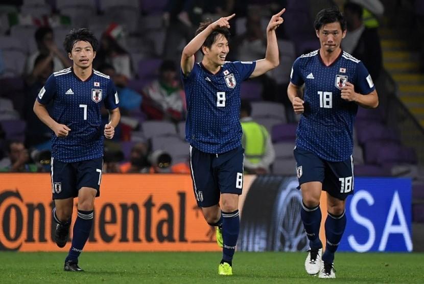 Pemain Jepang merayakan gol ketiga ke gawang Iran pada semifinal Piala Asia 2019.