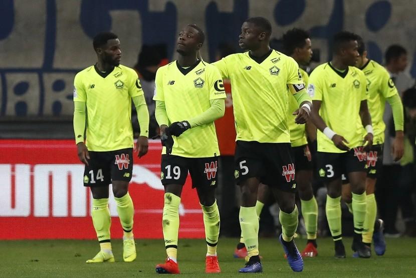 Pemain Lille melakukan selebrasi gol. (ilustrasi)