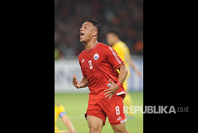 Pemain Persija Jakarta Addison merayakan gol-nya  usai memasukan bola kedalam gawang Song Lam Nghe An FC (VIE) dalam laga Piala AFC di Stadion Utama Gelora Bungkarno (SUGBK) Jakarta, Rabu (14/3).