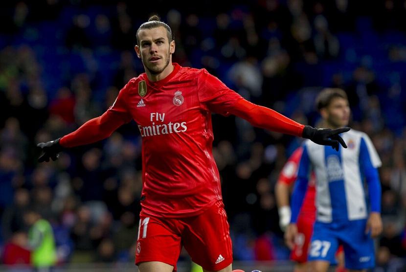 Pemain Real Madrid Gareth Bale merayakan gol usai menjebol gawang Espanyol dalam lanjutan La Liga di RCDE Stadium, Spanyol