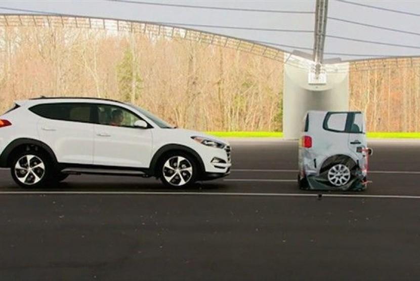 Pemerintah AS dan kalangan industri otomotif sedang membahas penempatan sistem rem otomatis pada kendaraan