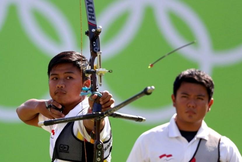 Pepanah Indonesia Riau Ega Agatha melaju ke perempat final beregu campuran Olimpiade Tokyo bersama Diananda Choirunisa.