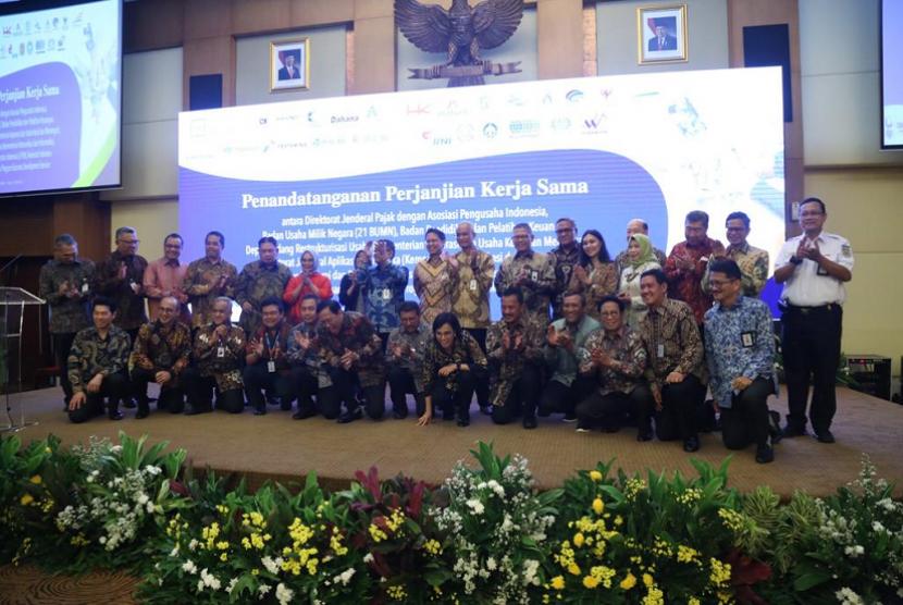 Perjanjian kerja sama Pertamina dan Ditjen Pajak untuk memperkuat UMKM nasional.