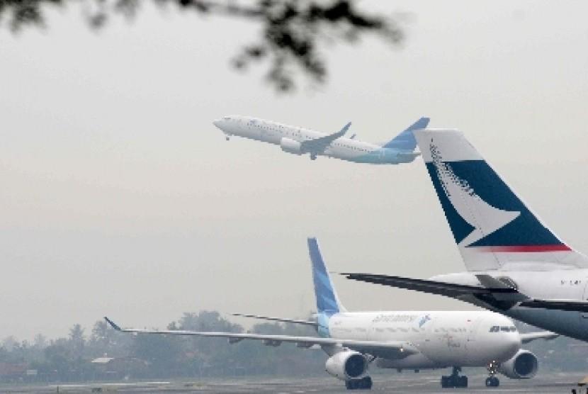 Pesawat parkir di Bandara Soekarno-Hatta, Tangerang.