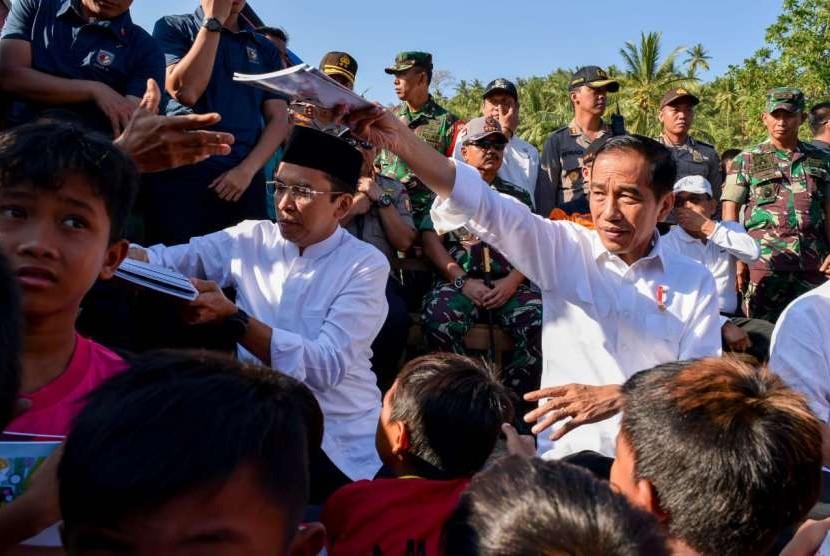 [ilustrasi] Presiden Joko Widodo (Jokowi) bersama Gubernur NTB TGB Zainul Majdi dan sejumlah menteri meninjau lokasi pengungsian di Lombok Utara, pada Senin (13/8) dan Selasa (14/8).