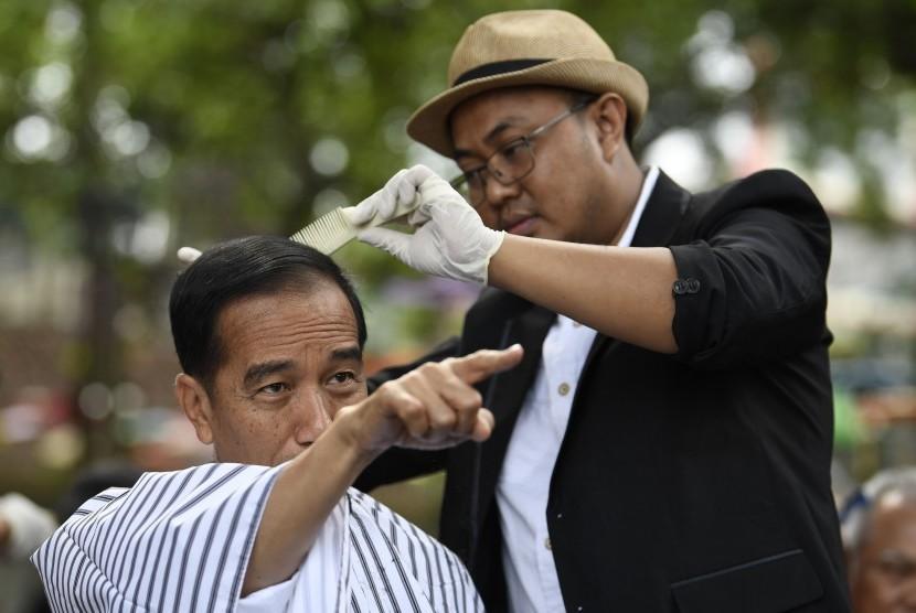 President Joko Widodo (left)