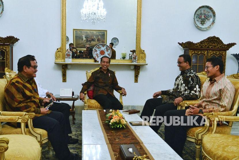 Presiden Jokowi bertemu dengan Gubernur DKI Anies Baswedan dan Wagub Sandiaga Uno.