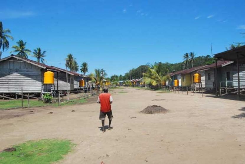 Program Nasional Pemberdayaan Masyarakat (PNPM) Mandiri  pengadaan  penampungan air bersih di kampung Timika, Kabupaten Mimika-Papua.
