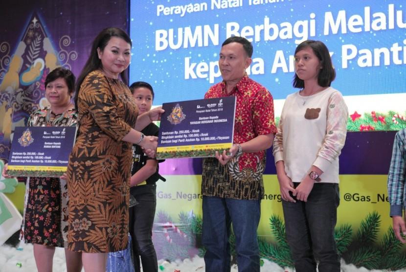 PT Perusahaan Gas Negara Tbk (PGN) bersama dengan PT Bukit Asam Tbk berbagi kebahagiaan Natal kepada 500 anak yatim dari 15 panti asuhan di Provinsi Riau, Sabtu (15/12).