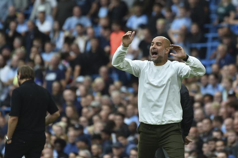 Reaksi pelatih kepala Manchester City Pep Guardiola.
